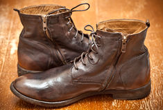 Leather shoes brown. Fashionable leather boots. Leather shoes brown. Fashionable leather high boots. autumn - spring shoes. cowboy style. Aged leather boots royalty free stock image