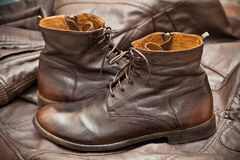 Leather shoes brown. Fashionable leather high boots Stock Photos