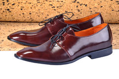 Leather shoes, designed with a slim elongated toe, made from a smooth brown leather. Royalty Free Stock Photo