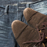 Leather shoes on jean pant Stock Photography
