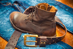 Leather shoes, leather belt with a gold buckle, jeans Stock Photography