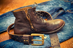 Leather shoes, leather belt with a gold buckle, jeans Royalty Free Stock Images