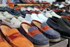 Leather shoes retail shop in rows varied colors. Arrangement royalty free stock photography