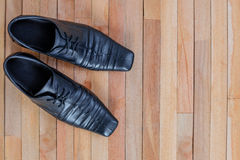 Leather shoes on top of wooden Stock Images