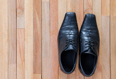 Leather shoes on top of wooden.  Royalty Free Stock Photos