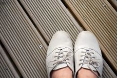 Leather shoes on wooden planks stock images