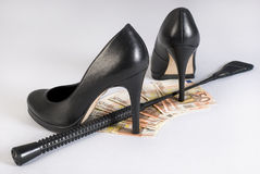 Leather Short Handle Crop, high heels and money. Stock Photography