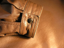 Leather Sleeve. Closeup of the sleeve cuff of a leather coat Stock Photos