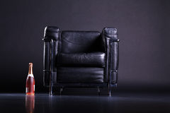 Leather sofa  with champagne bottle Stock Photos
