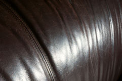 Leather sofa with character Royalty Free Stock Photos