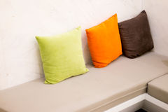 Leather sofa and colorful pillow Stock Images