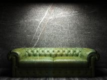 Leather sofa in dark room Stock Photo