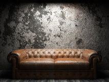 Leather sofa in dark room Stock Images