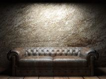 Leather sofa in dark room Stock Photography