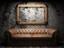 Leather sofa and frame in dark room Royalty Free Stock Photos