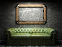 Leather sofa and frame in dark room. Made in 3D Royalty Free Stock Photo