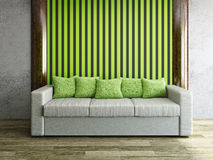 Leather sofa with green pillows Stock Photography