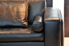 Leather sofa handle and pillow Royalty Free Stock Image