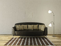 Leather sofa. And lamp  near the concrete wall Stock Photo