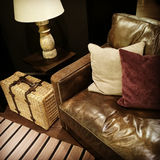 Leather sofa, lamp and rattan suitcase Royalty Free Stock Images