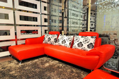 Leather sofa in living room. Real leather sofa in bright red color in modern style lving room, shown as modern, luxury or artistic life Royalty Free Stock Photos