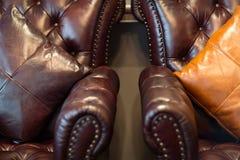Leather sofa and pillows Stock Photos