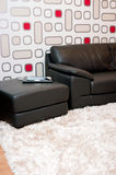 Leather sofa in stylish home Stock Images