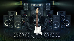 Leather sofa surrounded by speakers and electric guitar Stock Images