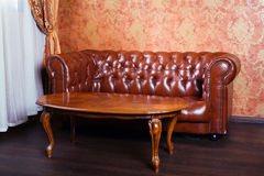 Leather sofa, vintage style luxury interior Stock Photos