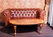 Leather sofa, vintage style luxury interior Stock Photos