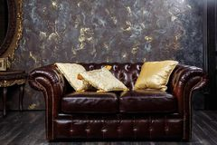 Leather sofa in vintage style luxury interior Stock Images