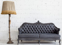 Leather sofa in white room stock photos