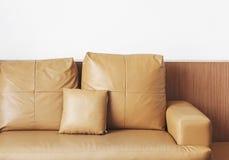 Leather sofa on white wall Royalty Free Stock Photos