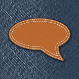 Leather speech bubble on jeans texture Royalty Free Stock Photos