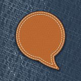 Leather speech bubble on jeans texture Stock Photography