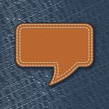 Leather speech bubble on jeans texture. Illustration Stock Photography