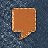 Leather speech bubble on jeans texture Stock Image