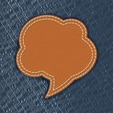 Leather speech bubble on jeans texture Royalty Free Stock Photography