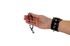 Leather and Spikes and rosary Stock Image