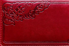 Leather with stamping ornament. Red stylish leather texture with stamp ornament Royalty Free Stock Images