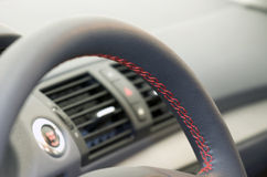 Leather steering wheel close up Stock Images