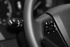 Leather steering wheel closeup in black and white. Black leather steering wheel closeup in black and white Royalty Free Stock Image