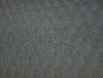 Leather stitched with blue hexagon or honecomb grey texture stock photos