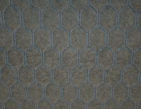 Leather stitched with blue hexagon or honecomb grey texture stock photography