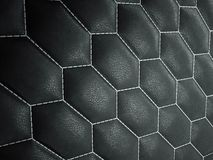 Leather stitched hexagon or honecomb black shiny texture stock photography