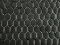 Leather stitched hexagon or honecomb black shiny texture stock photos