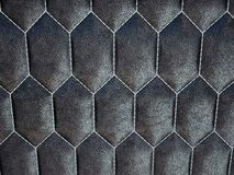 Leather stitched hexagon or honecomb black shiny texture royalty free stock photos