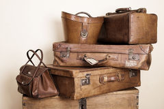 Leather stuff. Collection of leather suitcases and bags stacked Stock Photo