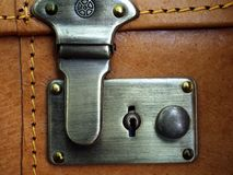 Leather suitcase. Close of of the lock on the leather suitcase royalty free stock photography