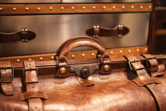 Leather suitcase close-up. Close-up fragment of locks and fasteners on the vintage leather suitcase brown Stock Image